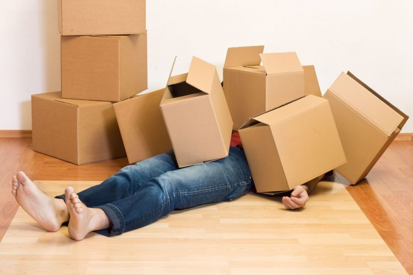 Boxes piled on man