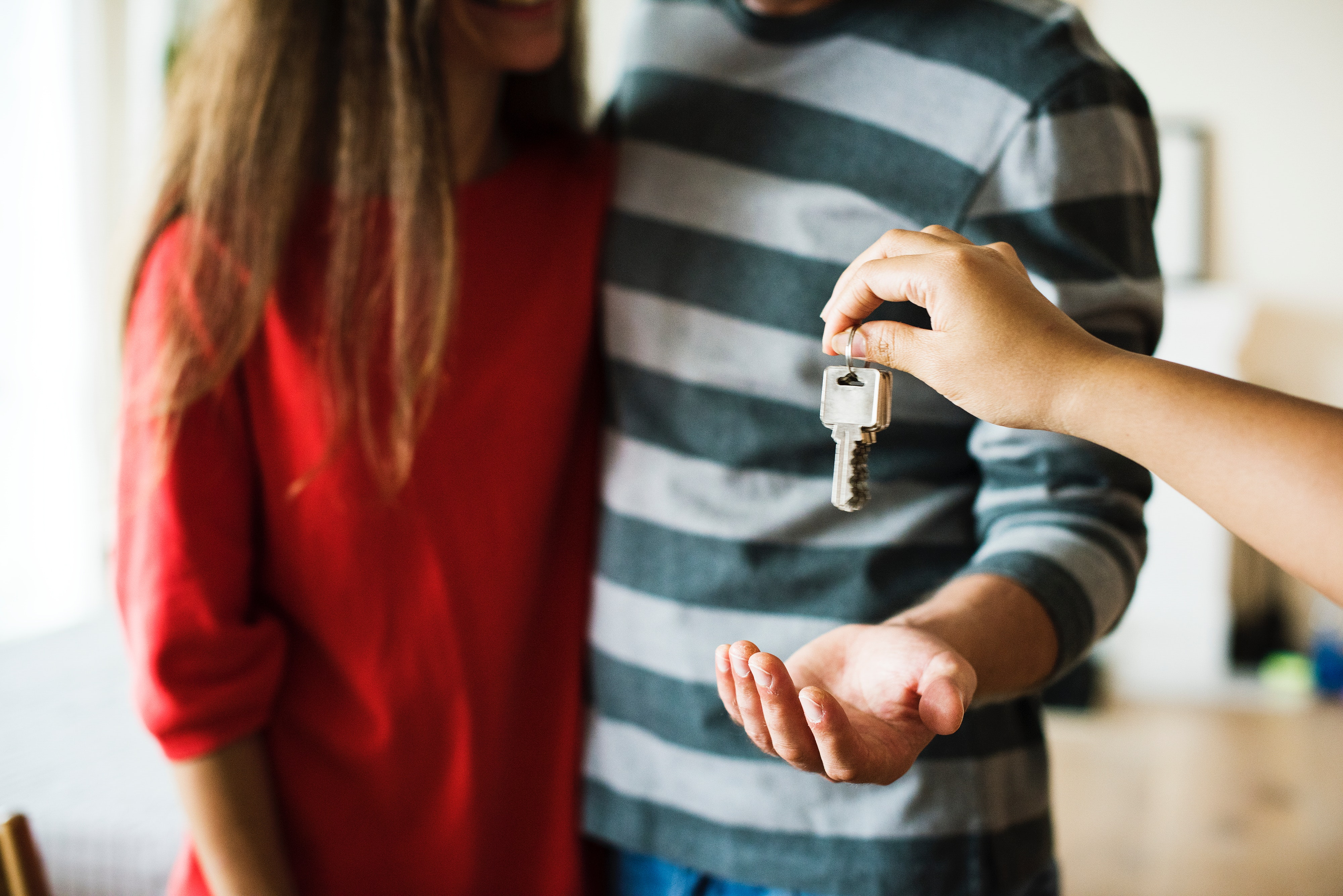 Couple being handed keys